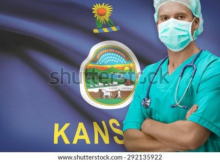 Surgeon with USA states flags on background - Kansas - stock photo