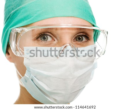 Surgeon woman in protective glasses and mask on whites background. - stock photo
