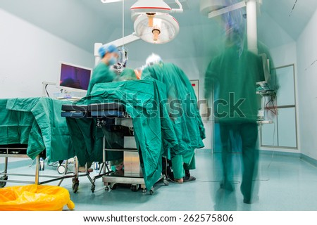 surgeons are operating in a hospital - stock photo