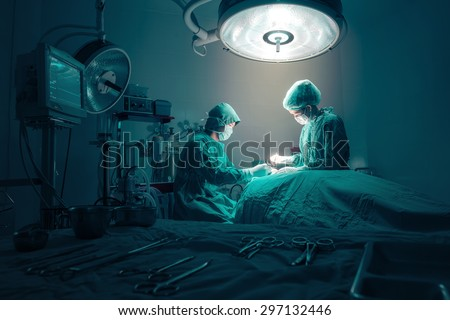 Surgeons team working with Monitoring of patient in surgical operating room. - stock photo
