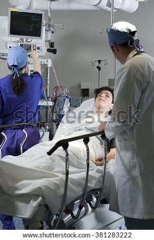 Surgeons with patient - stock photo