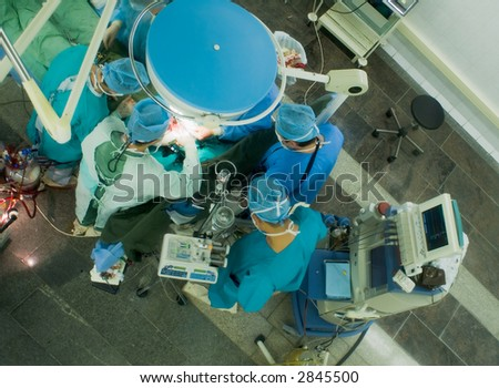 surgeons working in operation room. view from above - stock photo