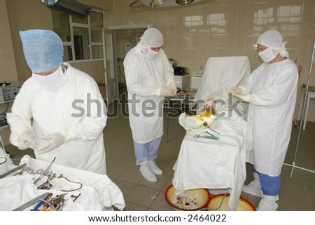 surgery team at work - stock photo