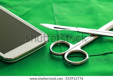 surgical instruments  and smart phone, selective focus - stock photo