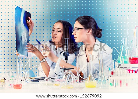 Surgical staff of the hospital are studying x-ray image. Laboratory equipment. - stock photo