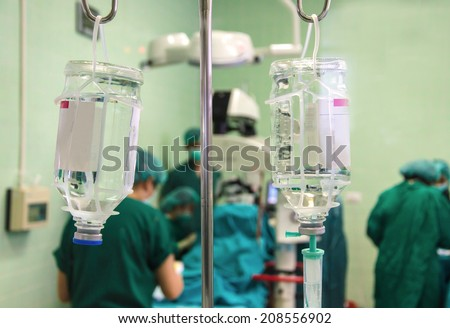 Surgical Team Working at Emergency Room In hospital. - stock photo
