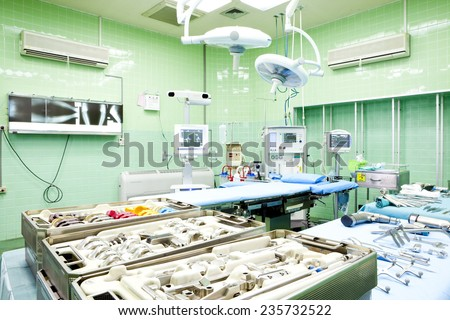 Surgical tools displayed on a surgical tray who need to oparate a patient in an operation room in a modern hospital - stock photo