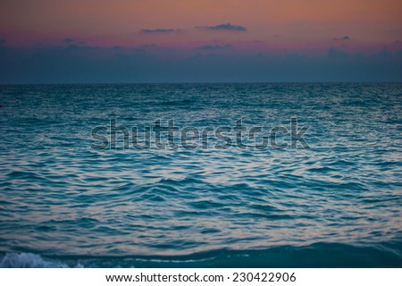 surging sea at dawn and gloomy sky - stock photo