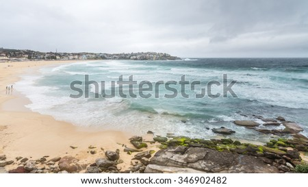 Surging waves from the Tasman Sea break upon a deserted Bondi Beach, New South Wales, Australia. - stock photo