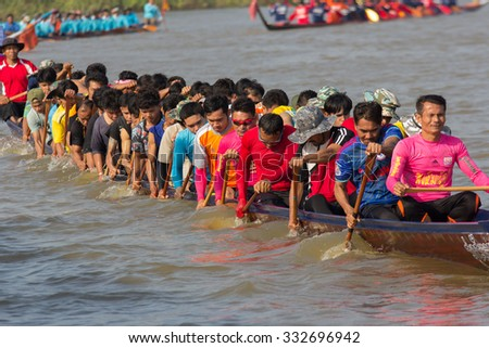SURIN THAILAND-OCT-28: Unidentified rowers in Climbing Bows toward Snatching a Flag native Thai long boats compete during Native Long Boat Race Championship on OCT 28, 2015 in SURIN, Thailand.