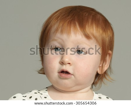 Surly toddler displays a superior attitude - stock photo