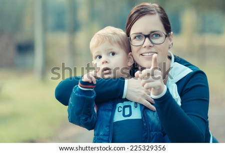 surpised kid with his mother in nature - stock photo