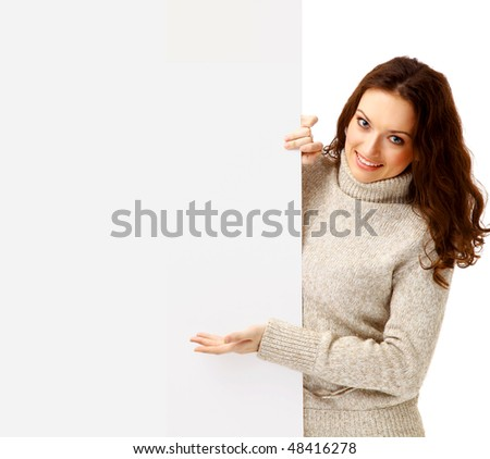 Surpriced woman holding sign - Portrait of a beautiful woman holding a blank billboard. - stock photo