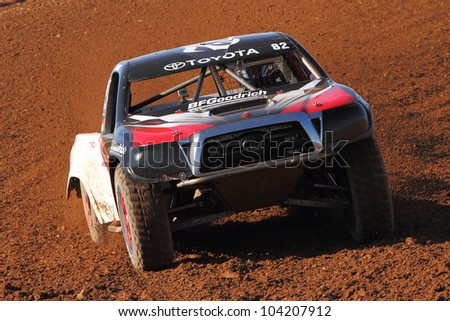 SURPRISE, AZ - APR 16: Chris Brandt (82) at speed in Lucas Oil Off Road Series Pro Lite Unlimited racing on April 16, 2011 at Speedworld Off Road Park in Surprise, AZ. - stock photo