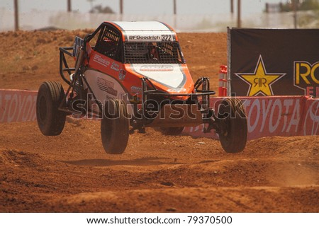 SURPRISE, AZ - APR 16: Geoffrey Cooley (322) at speed in round 3 action of Lucas Oil Off Road Series Limited Buggy racing on April 16, 2011 at Speedworld Off Road Park in Surprise, AZ. - stock photo