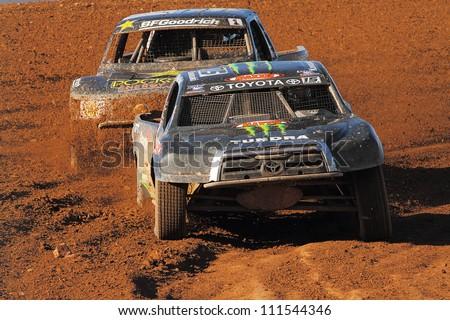 SURPRISE, AZ - APR 16: Marty Hart (15) leads Rob McCahren (1) during Pro 2 Unlimited Lucas Oil Off Road Series racing on April 16, 2011 at Speedworld Off Road Park in Surprise, AZ. - stock photo