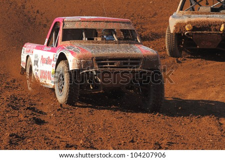 SURPRISE, AZ - APR 16: Rodrigo Ampudia (36) at speed in Lucas Oil Off Road Series Pro Lite Unlimited racing on April 16, 2011 at Speedworld Off Road Park in Surprise, AZ. - stock photo