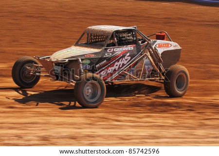 SURPRISE, AZ - APRIL 16:  CJ Greaves (33) at speed in Pro Buggy Unlimited Lucas Oil Off Road Series racing on April 16, 2011 at Speedworld Off Road Park in Surprise, AZ. - stock photo