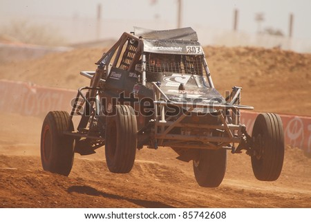 SURPRISE, AZ - APRIL 16: Toby Bost (307) at speed in round 3 action of Lucas Oil Off Road Series Limited Buggy racing on April 16, 2011 at Speedworld Off Road Park in Surprise, AZ.
