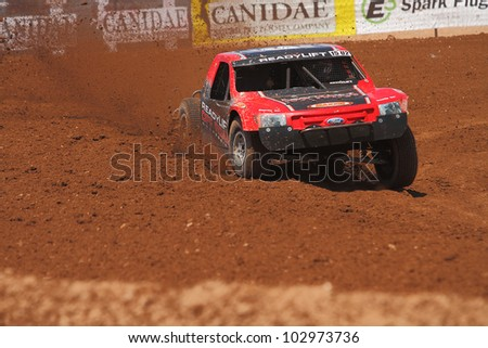 SURPRISE, AZ - MAY 18: Marty Hart (15) at speed in Lucas Oil Off Road Series racing Pro 2 Unlimited practice on May 18, 2012 at Speedworld Off Road Park in Surprise, AZ. - stock photo
