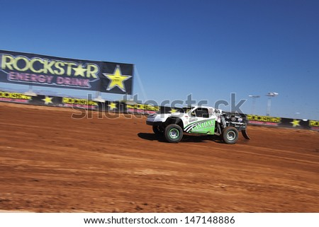 SURPRISE, AZ - SEP 23: Jeff Geiser (44) at speed in Pro 2 Unlimited Lucas Oil Off Road Series practice on Sept. 23, 2011 at Speedworld Off Road Park in Surprise, AZ.  - stock photo
