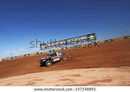 SURPRISE, AZ - SEP 23: Kyle LeDuc (99) at speed in Pro 4 Unlimited Lucas Oil Off Road Series practice on Sept. 23, 2011 at Speedworld Off Road Park in Surprise, AZ.  - stock photo