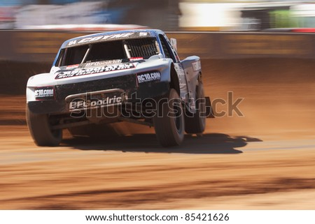 SURPRISE, AZ - SEPT 24: Travis Coyne (5) at speed in Pro 4 Unlimited qualifying for Lucas Oil Off Road Series racing on Sept. 24, 2011 at Speedworld Off Road Park in Surprise, AZ. - stock photo