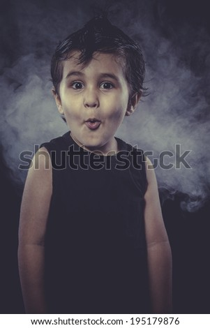 Surprise, boy with funny hair crest and appearance of rocker - stock photo