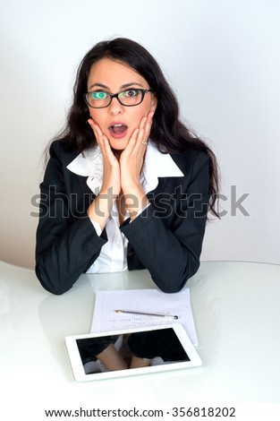 surprise business woman with tablet at work - stock photo