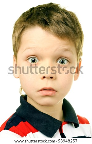 Surprise concept - boy with funny amazed expression on white background - stock photo