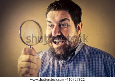 Surprise through the magnifying glass - stock photo