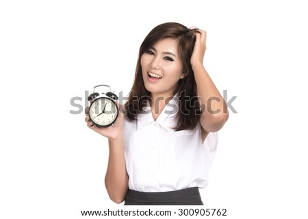 Surprise young asian woman looking at alarm clock with blank copy space,Closeup portrait of beautiful Asian woman,Thai girl,Positive human emotion facial expression,isolated on white background