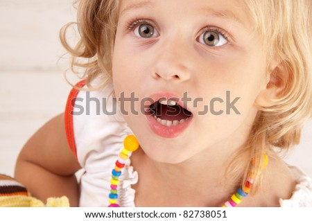 Surprised amazed little girl close-up - stock photo