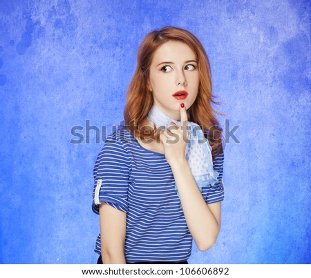 Surprised american redhead girl in suglasses. Photo in 60s style. - stock photo