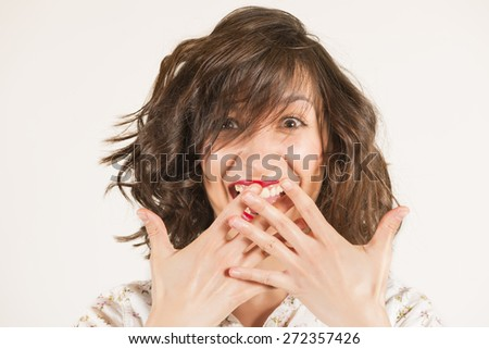 Surprised and happy young woman.. Expressive portrait of a beautiful brunette girl in studio on white background - stock photo