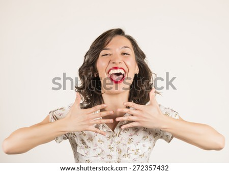 Surprised and happy young woman. Expressive portrait of a beautiful brunette girl in studio on white background,  - stock photo