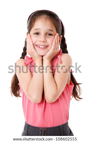 Surprised and smiling little girl, isolated on white
