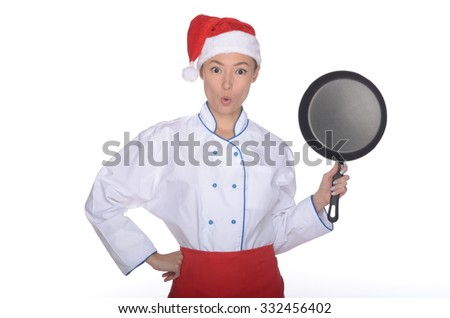 surprised asian chef with frying pan and Christmas hat isolated in white - stock photo