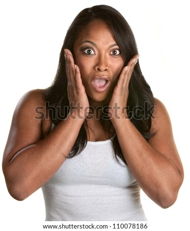 Surprised athletic African woman with hands on face - stock photo