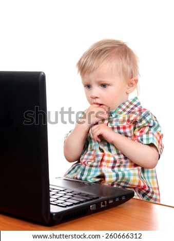 Surprised Baby Boy with Laptop Isolated on the White Background