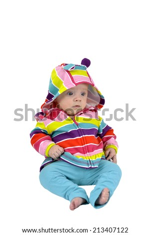 Surprised baby girl with multicolored cardigan isolated on white  - stock photo