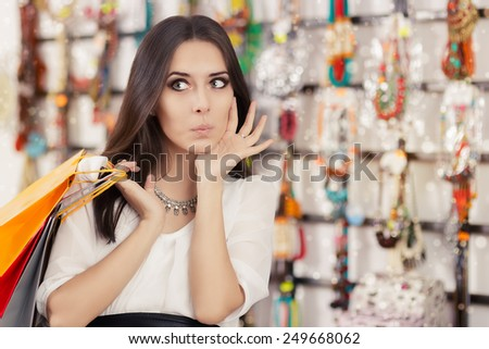 Surprised Beautiful Woman Shopping  - Portrait of an amazed young girl with shopping bags in trendy store  - stock photo