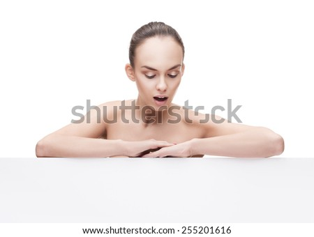 surprised beautiful young woman with clean fresh skin and copyspase - stock photo