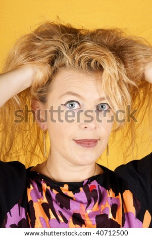 Surprised blond woman over a yellow background