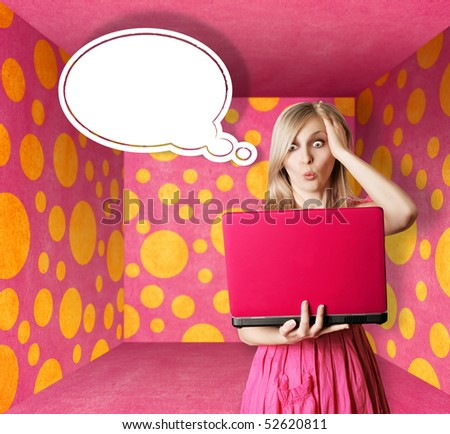 surprised blonde in pink dress with thought bubble and laptop in pink room - stock photo
