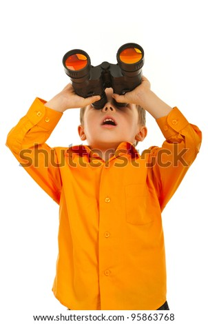 Surprised boy looking up through binocular siolated on white background