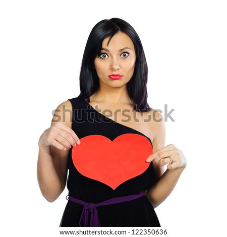 Surprised brunette girl with red Valentine heart isolated on white background - stock photo