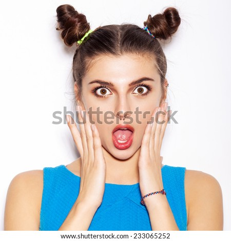 Surprised Brunette Woman. Beauty girl with bright makeup hairstyle with horns in a blue dress having fun. On a white background, not isolated - stock photo