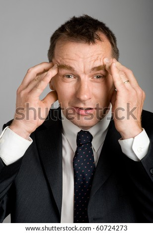 Surprised business man - stock photo