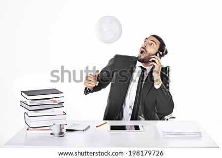 Surprised business man hitting the ball with head - stock photo